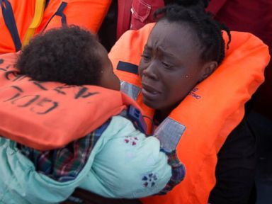 PHOTO: A mother holds her daughter after being rescued at sea off the coast of Libya, Feb. 3, 2017.