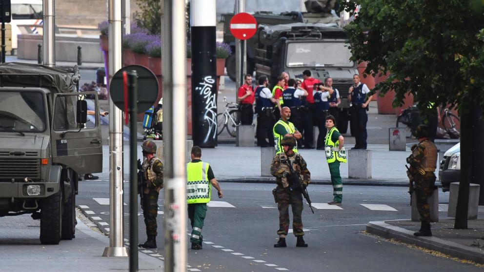Belgian Army soldiers and police patrol outside Central Station after a reported explosion in Brussels on June 20, 2017.