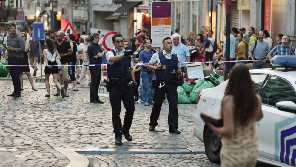 Belgian police evacuate people near the Grand Place near Central Station in Brussels after a reported explosion on Tuesday, June 20, 2017.