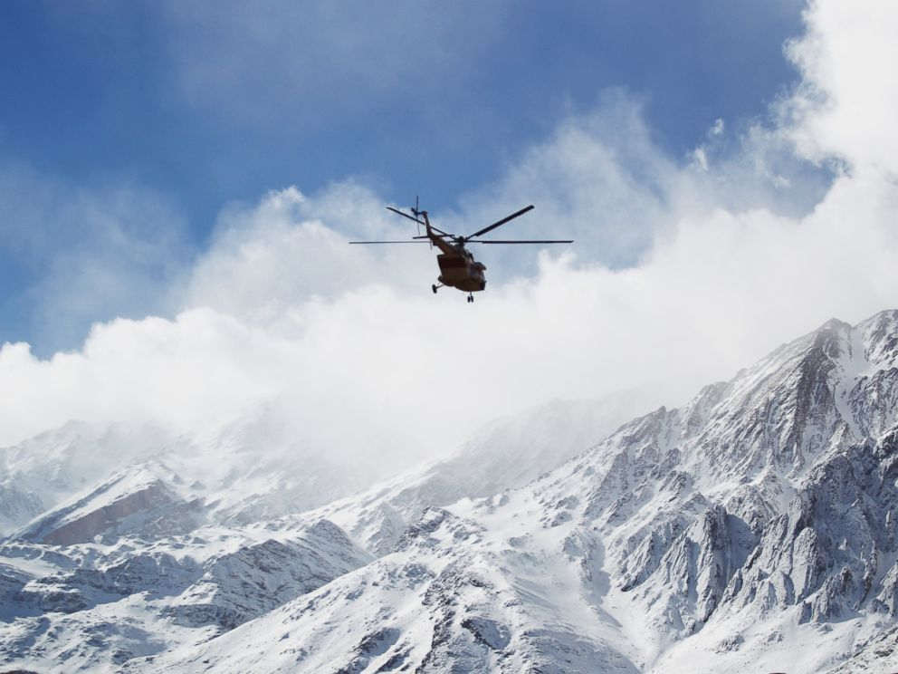 News Agency a rescue helicopter flies over the Dena mountains while searching for wreckage of a plane that crashed on Sunday in southern Iran Monday Feb. 19 2018