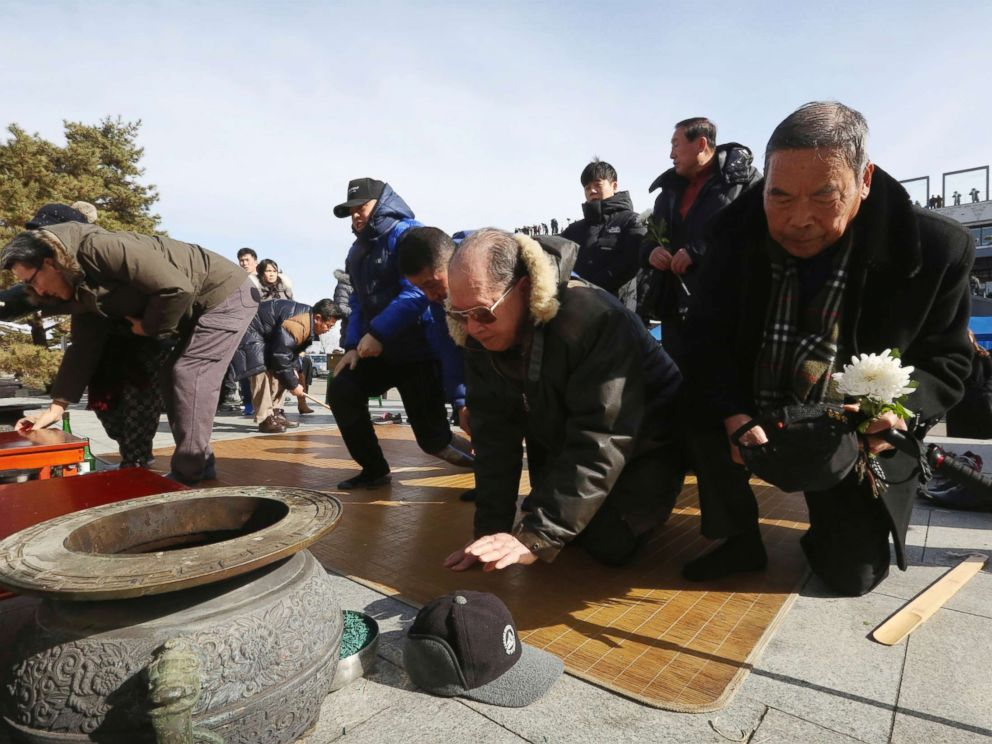 north korean refugees and their family members bow to respect their ancestors in north korea as