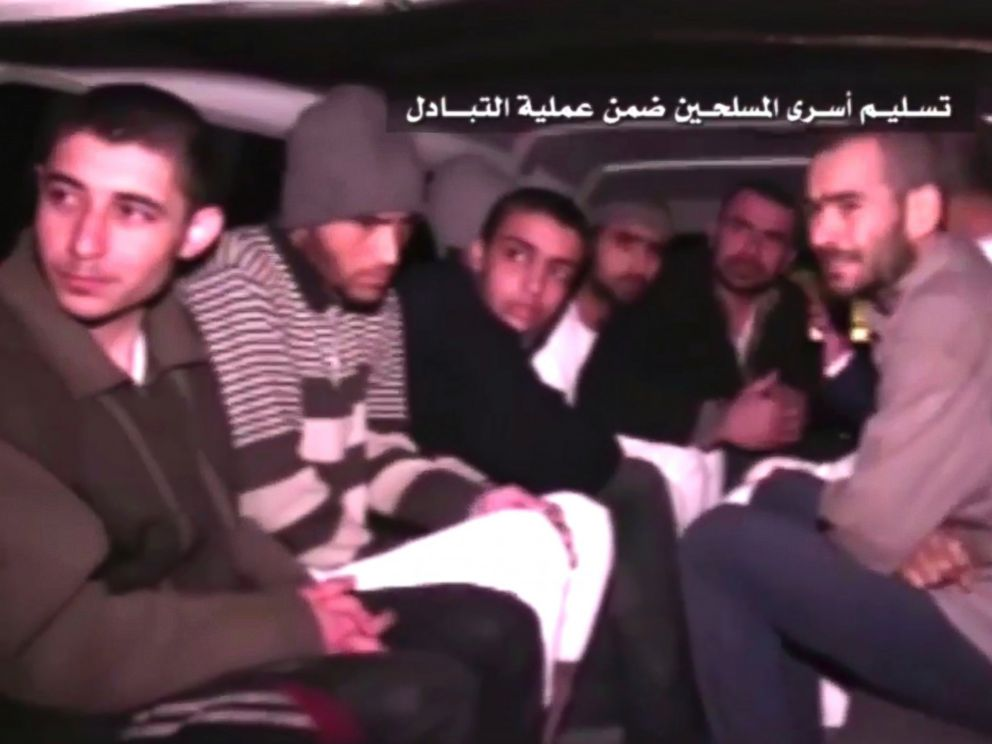 PHOTO: This frame grab shows Syrian rebels sitting inside a vehicle of the Syrian Arab Red Crescent after they were released as part of a deal to evacuate over 10,000 residents from Madaya and Zabadani in northern Syria, April 12, 2017.