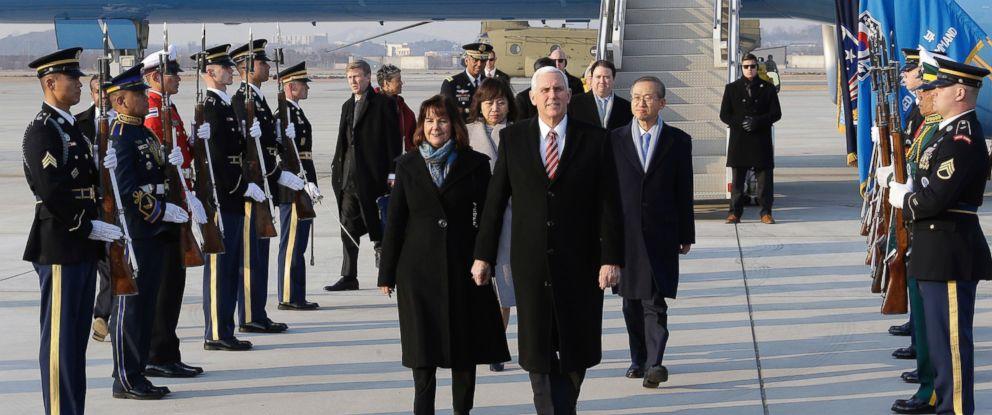 U.S. Vice President Mike Pence and his wife Karen Pence arrive at Osan Air Base in Pyeongtaek, South Korea, Thursday, Feb. 8, 2018.