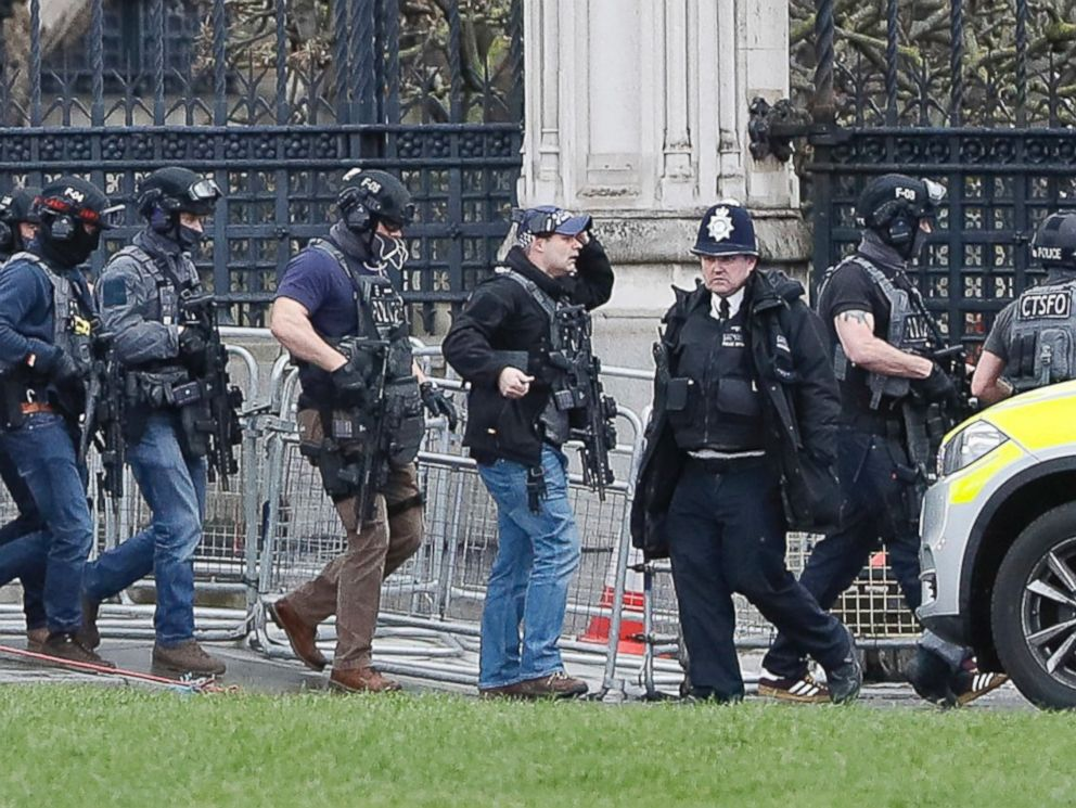 PHOTO: Armed police officers enter the Houses of Parliament in London, March 23, 2017 after the House of Commons sitting was suspended as witnesses reported sounds like gunfire outside.