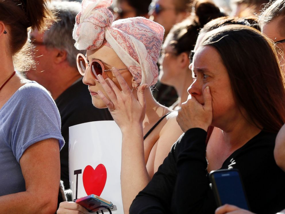 PHOTO: People attend a vigil in Albert Square, Manchester, England, May 23, 2017, the day after the suicide attack at an Ariana Grande concert that left 22 people dead as it ended on Monday night.
