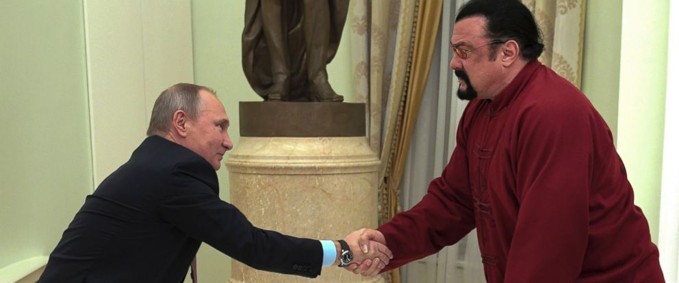 PHOTO: Vladimir Putin shakes hands with Steven Seagal at the Kremlin in Moscow, Nov. 25, 2016.