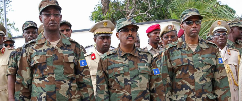 PHOTO: Somali President Mohamed Abdullahi Mohamed, center, Somalia Prime Minister Hassan Ali Khayre, right, and Defense Minister Abdirashid Abdulahi Mohamed, watch a military unit during an event in Mogadishu, Somalia, April 12, 2017.