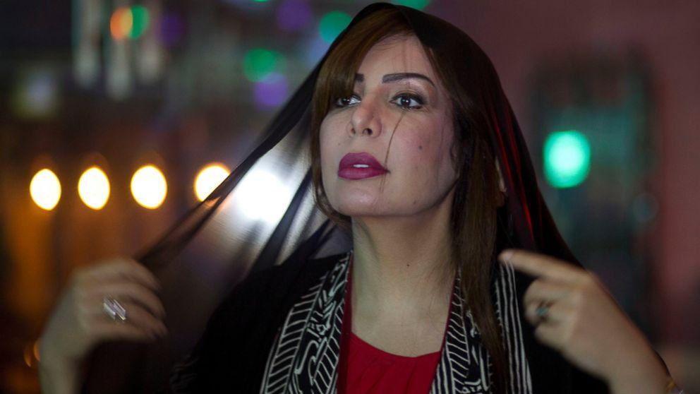 Saudi women's rights activist Souad al-Shammary puts on a head scarf in Jiddah, Saudi Arabia, May 7, 2016.