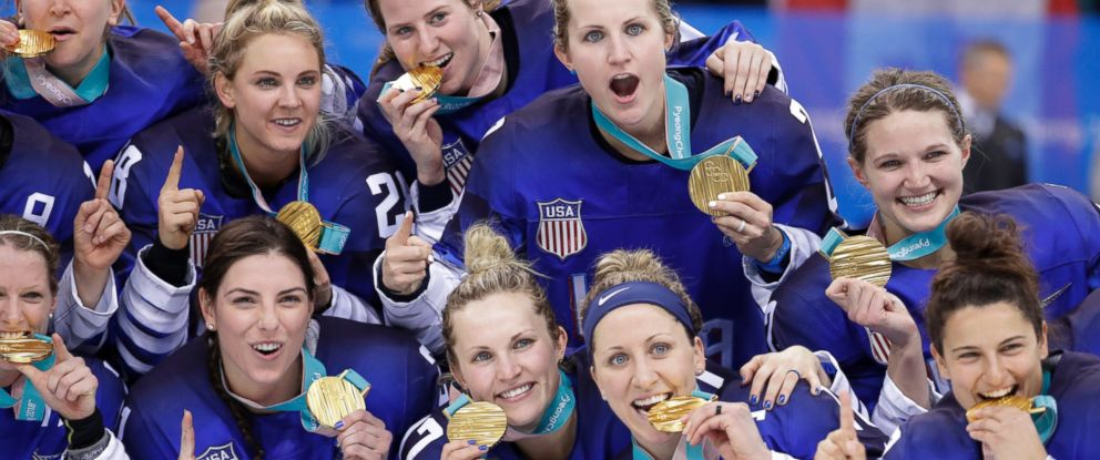 Untied States hockey team celebrate with their gold medals after beating Canada in the womens gold medal hockey game at the 2018 Winter Olympics in Gangneung, South Korea, Thursday, Feb. 22, 2018.