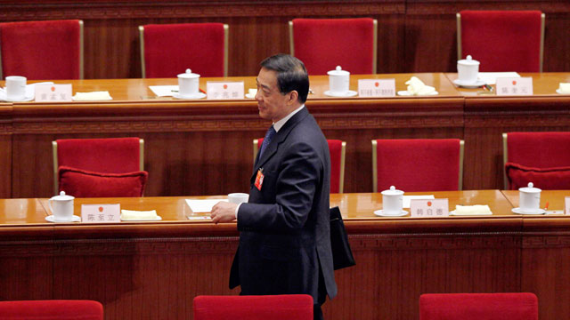 PHOTO: Chongqing party secretary Bo Xilai walks past deserted seats after a plenary session of the National People's Congress in Beijing, China, March 9, 2012.