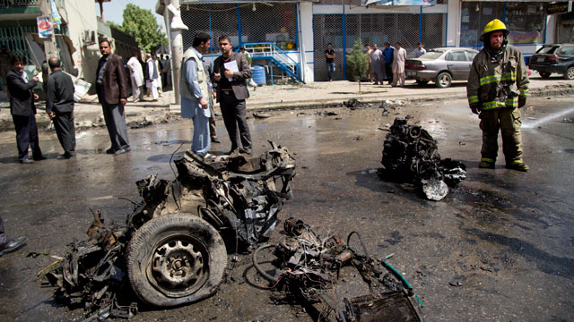 PHOTO: An Afghan fireman stands next to the debris of a car at the scene where a suicide car bomber attacked a NATO convoy in Kabul, Afghanistan, May 16, 2013.