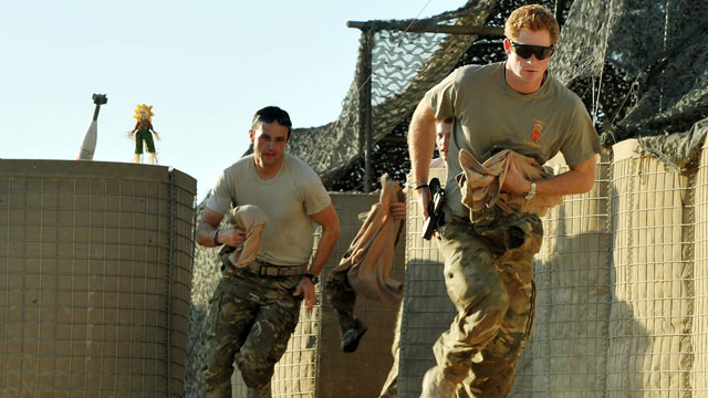 PHOTO: Prince Harry races out from the VHR (very high ready-ness) tent to scramble his Apache with fellow Pilots, during his 12 hour shift at the British controlled flight-line in Camp Bastion southern Afghanistan, Nov. 3 2012.