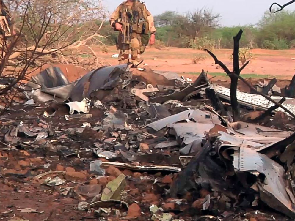 PHOTO: This photo provided on July 25, 2014 by the French army shows soldiers at the site of the plane crash in Mali.