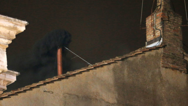 PHOTO: Blake smoke emerges from the chimney on the roof of the Sistine Chapel, in St. Peters Square at the Vatican, March 12, 2013. The black smoke indicates that the new pope has not been elected yet.
