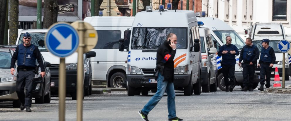 PHOTO: Police secure an area during a house search in the Etterbeek neighborhood in Brussels on Saturday April 9, 2016.