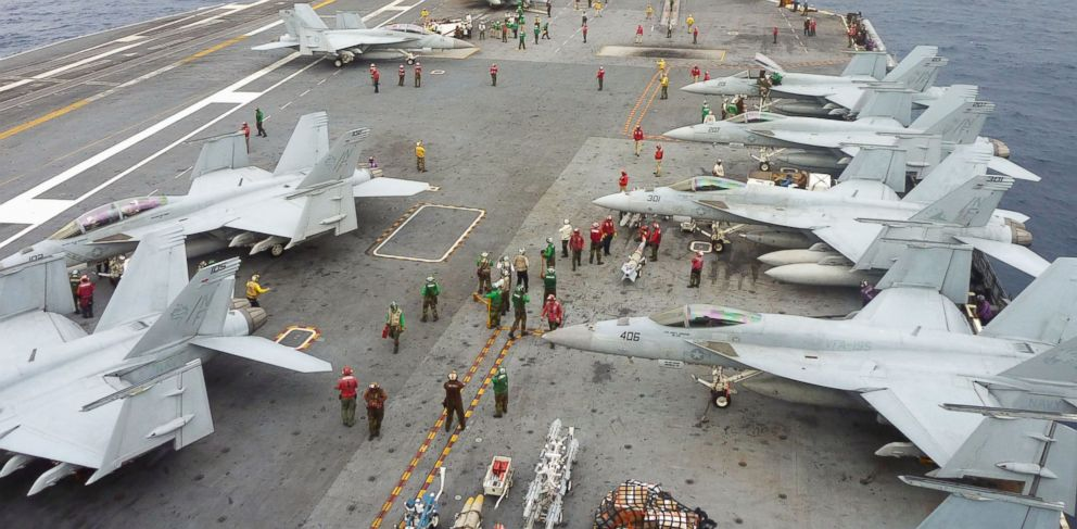 PHOTO: U.S. Navy FA-18 Hornets cram the flight deck of the USS George Washington during a joint military exercise with Japan in the Pacific Ocean near Okinawa on Nov. 28, 2013.