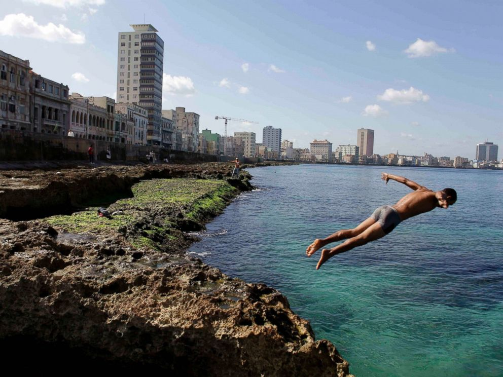 PHOTO: In this Nov. 28, 2011, file photo, a boy jumps into the water at the Malecon in Havana, Cuba.
