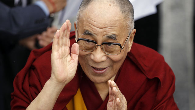 PHOTO: Exiled Tibetan spiritual leader the Dalai Lama greets people during a visit to Londonderry, Northern Ireland, April 18, 2013.