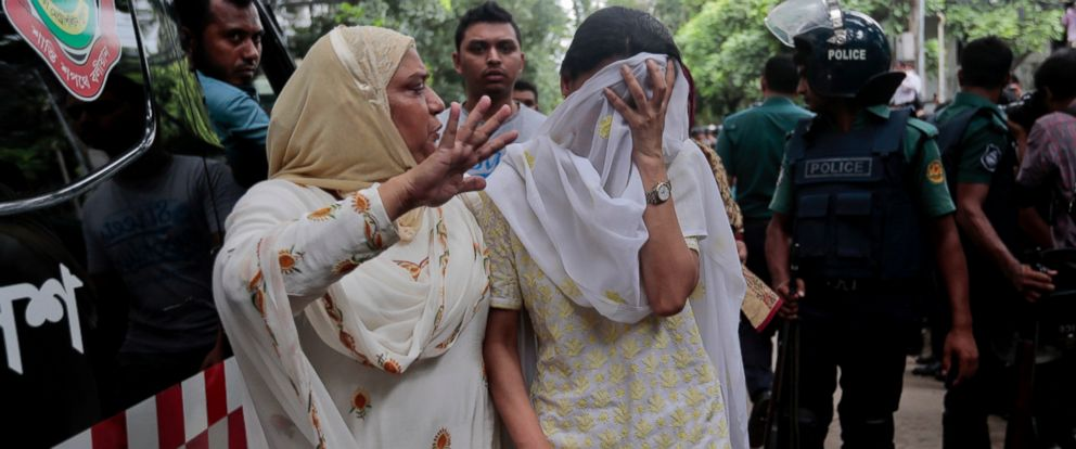 PHOTO: A relative tries to console Bangladeshi woman Semin Rahman, center, whose son is missing after militants took hostages in a restaurant popular with foreigners in Dhaka, Bangladesh, Saturday, July 2, 2016.