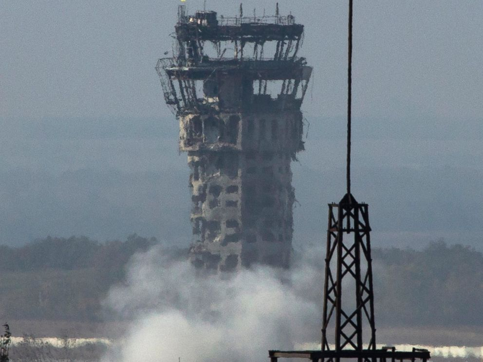 PHOTO: Smoke rises near the traffic control tower of Donetsk Sergey Prokofiev International Airport during artillery battle between pro-Russian rebels and Ukrainian government forces in the town of Donetsk, eastern Ukraine, Oct. 8, 2014.