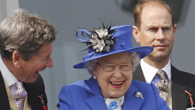 PHOTO:Britains Queen Elizabeth II, center, reacts as she looks out from the balcony at the end of the Epsom Derby horse race at Epsom racecourse England at the start of a four-day Diamond Jubilee celebration to mark the 60th anniversary of Queen Elizabe