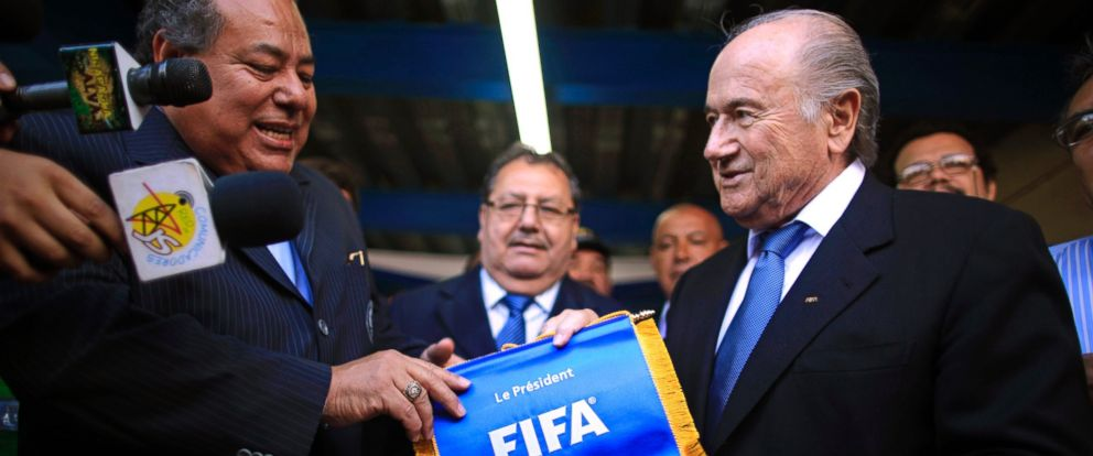 PHOTO: FIFA President Sepp Blatter, right, gives a FIFA pennant to Nicaraguas Soccer Federation President Julio Rocha during the inauguration of the construction of a new National Soccer Stadium in Managua, Nicaragua on April 14, 2011.