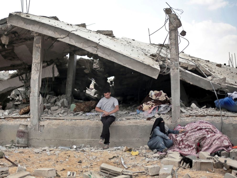 PHOTO: A Palestinian sits in front of a destroyed house in Rafahs district of Shawkah in the southern Gaza Strip, Aug. 5, 2014.