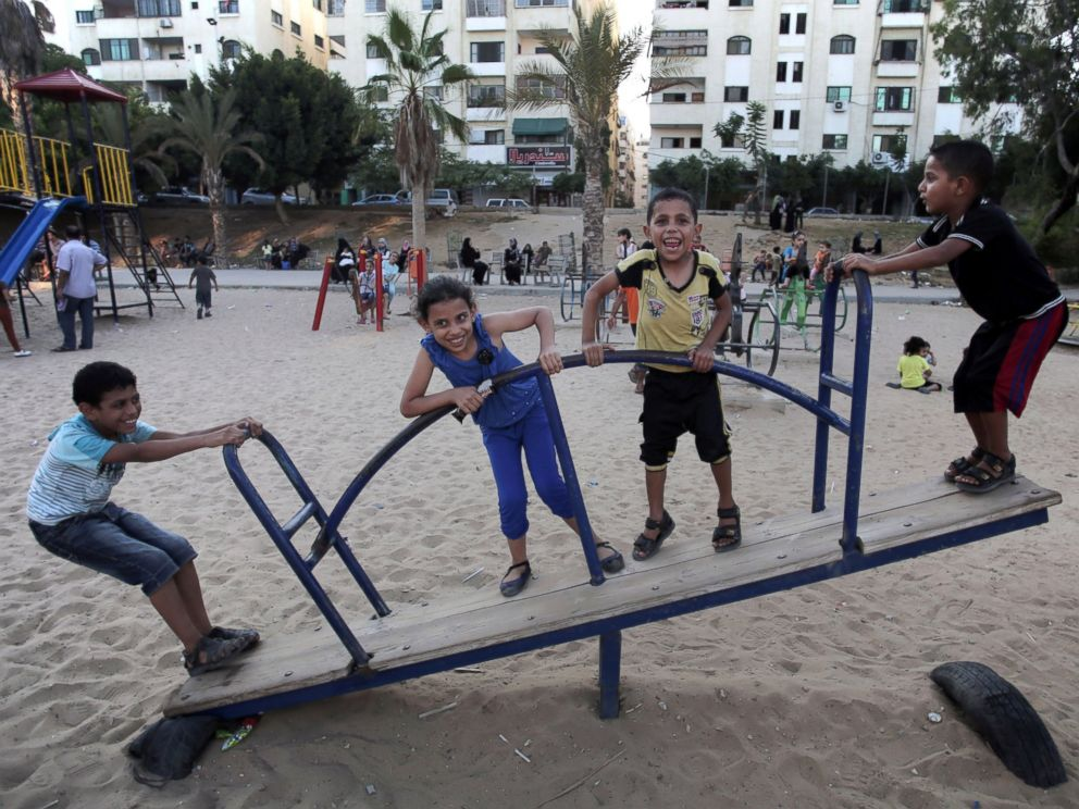 PHOTO: Palestinian children play in a public park during a temporary Hamas and Israel cease fire in Gaza City, Aug. 5, 2014.
