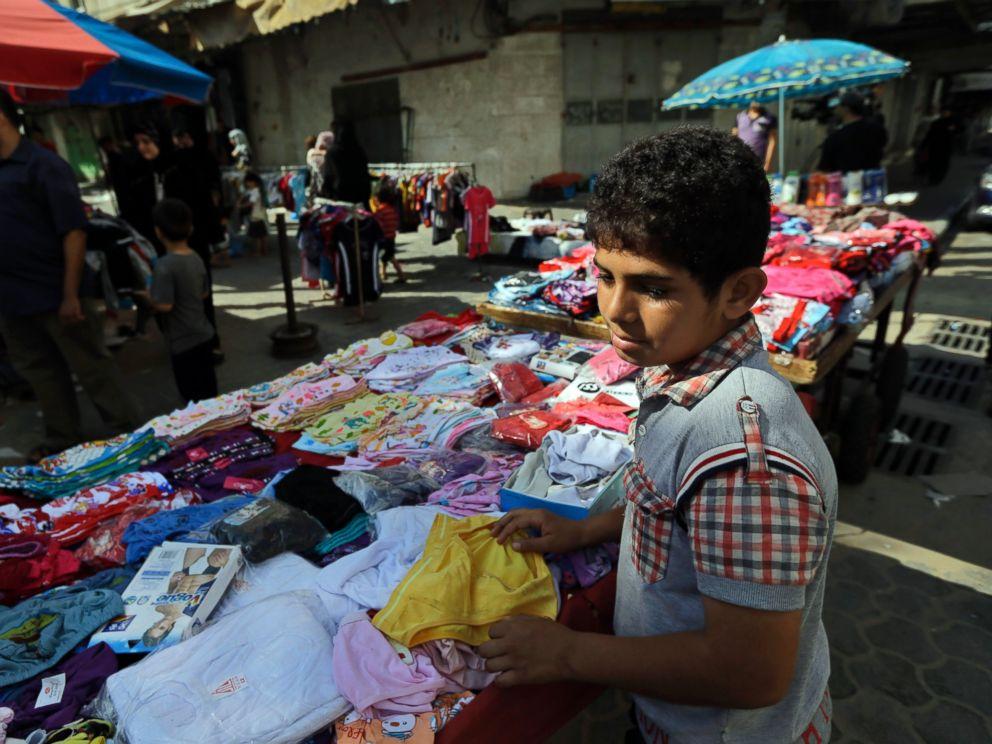 PHOTO: A Palestinian vendor arranges his merchandise at a market in Gaza City, northern Gaza Strip, Aug. 6, 2014.