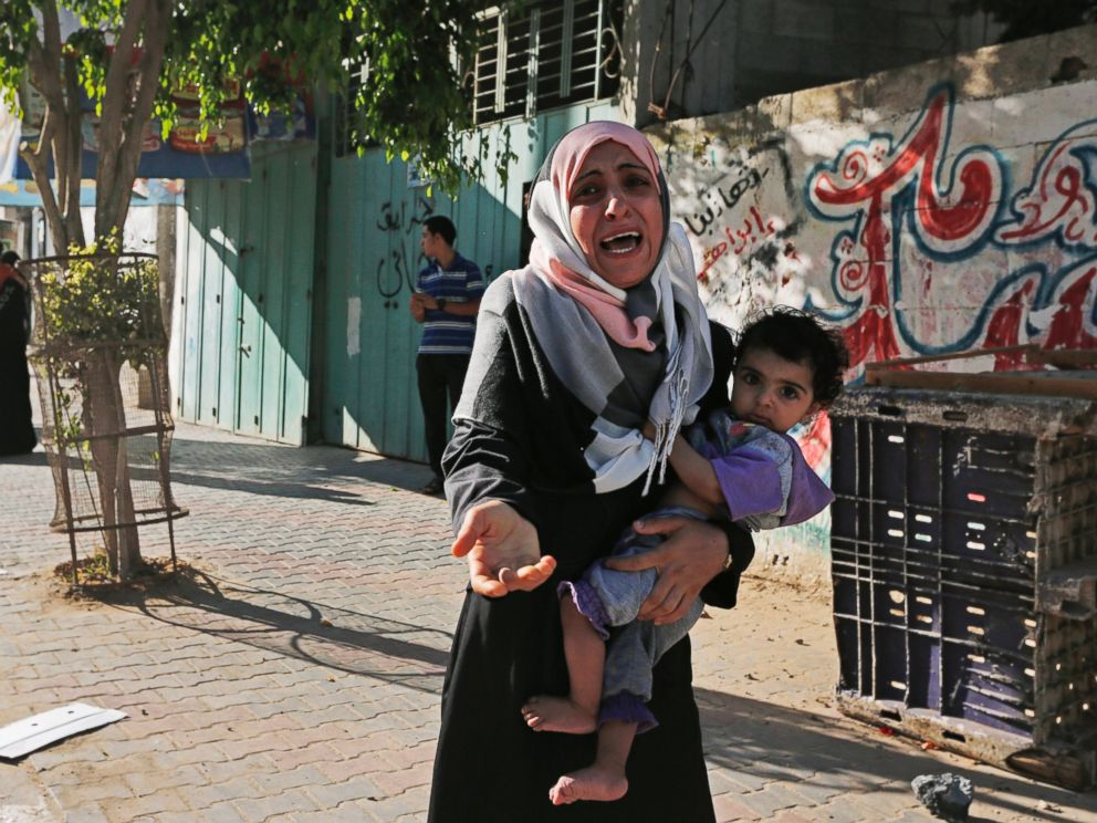 PHOTO: A woman cries as Palestinians flee their homes in the Shajaiyeh neighborhood of Gaza City, after Israel had airdropped leaflets warning people to leave the area, July 16, 2014.