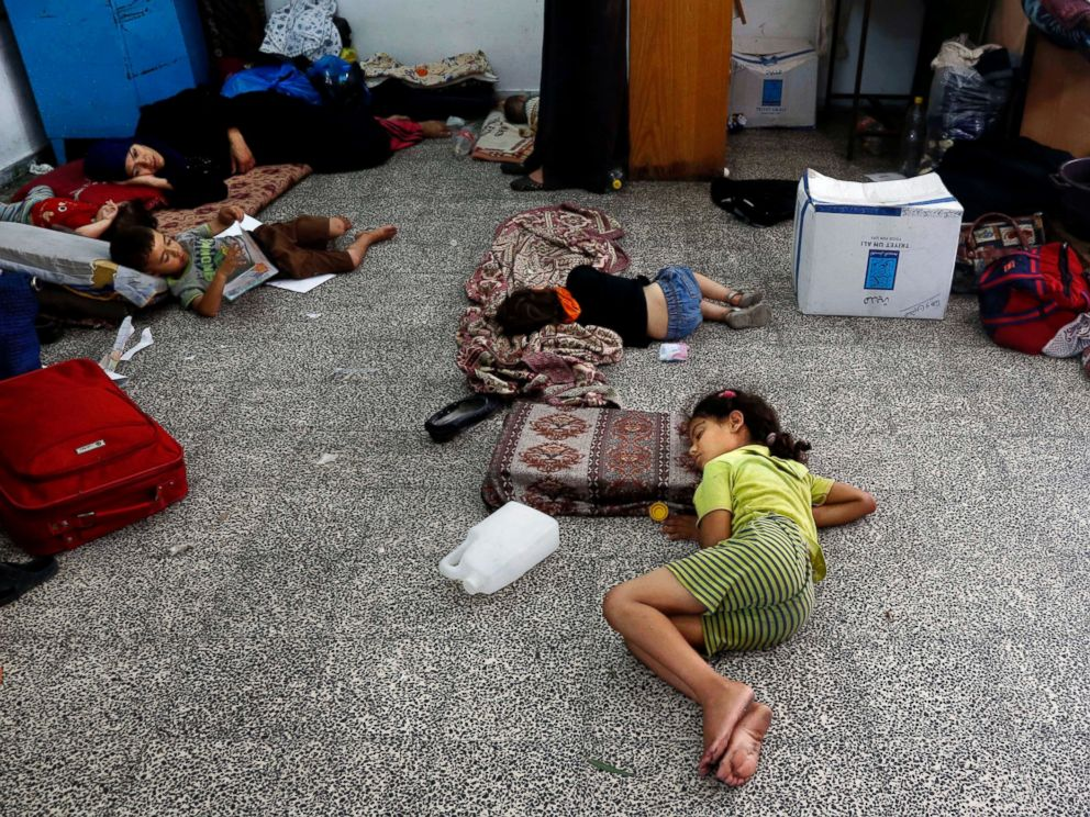 PHOTO: Palestinian children lay on the floor at the Abu Hussein school in the Jebaliya refugee camp, northern Gaza Strip, on July 30, 2014.