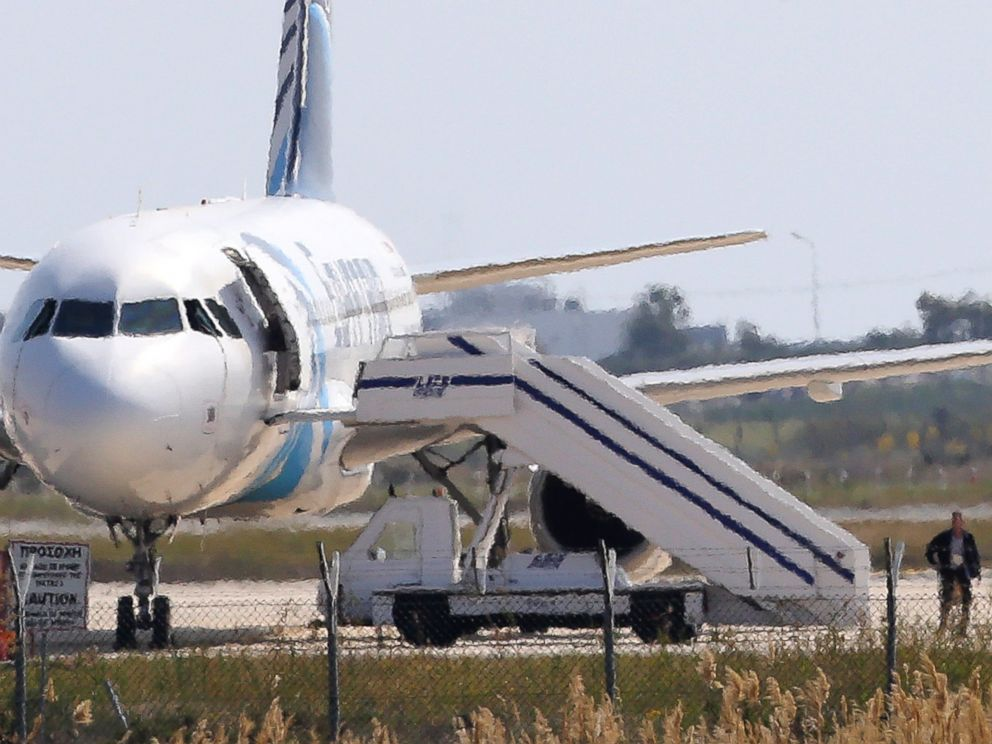 PHOTO: A man leaves the hijacked Egyptair plane at Larnaca airport on the island of Cyprus, March 29, 2016.