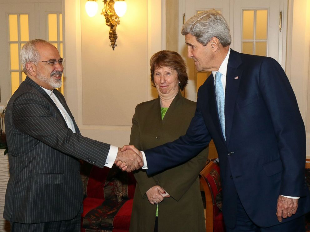 PHOTO: Iranian Foreign Minister Mohammad Javad Zarif shakes hands with U.S. Secretary of State John Kerry as former EU foreign policy chief Catherine Ashton looks prior to closed-door nuclear talks with Iran in Vienna, Austria, Nov. 20, 2014.