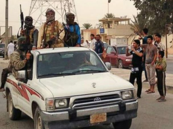 PHOTO: In this July 29, 2014 photo, Islamic militants parade in Beiji, Iraq.