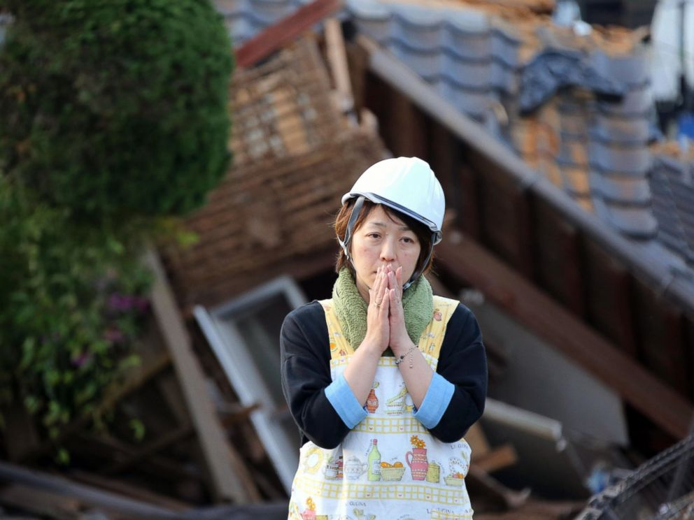 PHOTO: A resident stands in front of damaged house in Mashiki, Kumamoto prefecture, southern Japan, April 16, 2016.