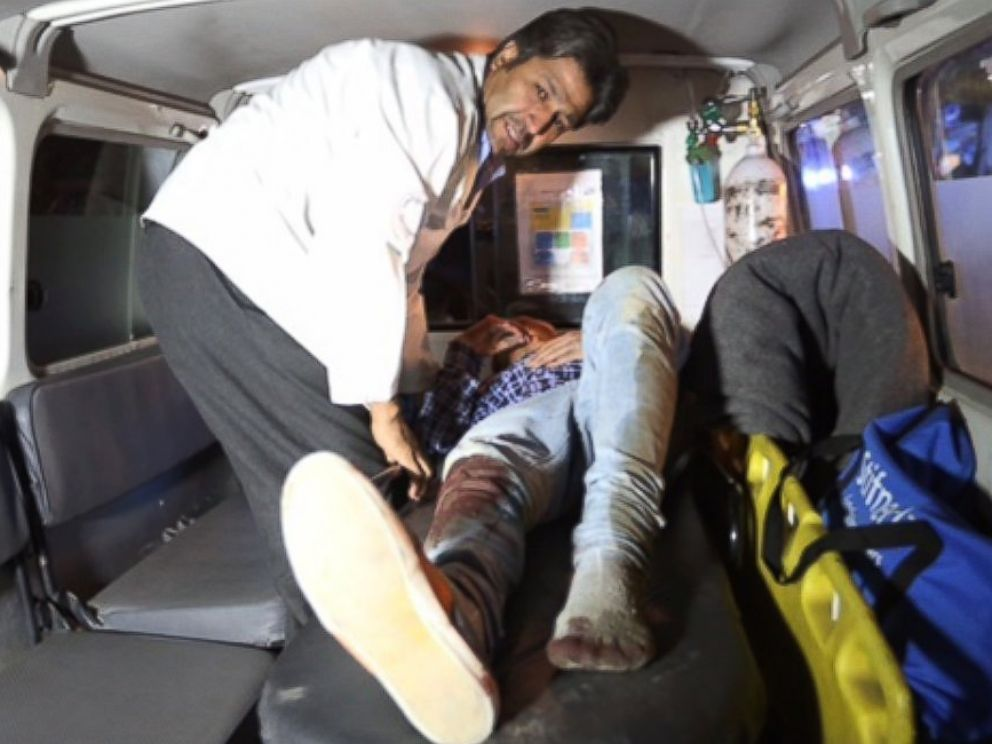 PHOTO: A wounded person is treated in an ambulance after an attack on the campus of the American University in the Afghan capital Kabul on Aug. 24, 2016.