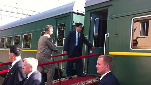 PHOTO: Kim Jong Il, walks up a ramp to enter the carriage of his armored train at the Bureya railway station, eastern Siberia, Russia, on his way to meet Russian President Dmitry Medvedev, August 21, 2011.