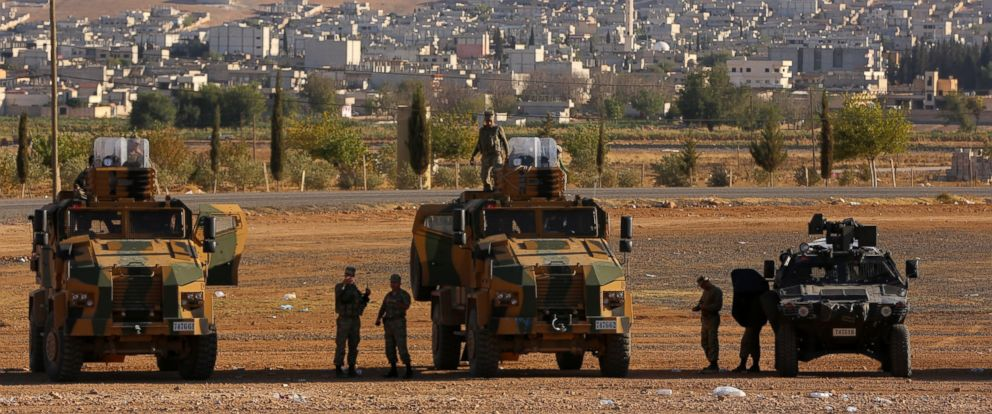PHOTO: Turkish soldiers position a few hundreds meters from the border line as fighting intensified between Syrian Kurds and the militants of Islamic State in Kobani in Syria, in the background, near Suruc, Turkey, Oct. 4, 2014.