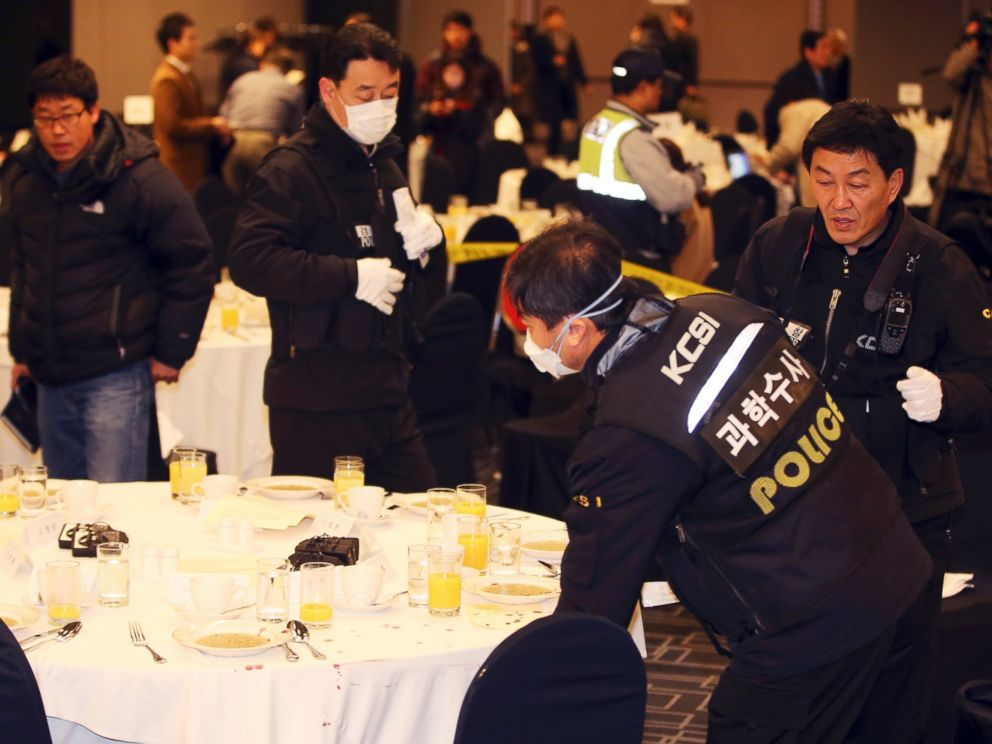 PHOTO: Police officers investigate the table where U.S. Ambassador to South Korea Mark Lippert sat at a lecture hall in Seoul, South Korea, March 5, 2015.