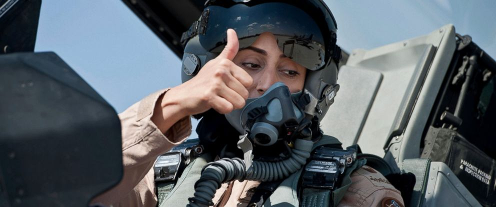 PHOTO:Mariam Al Mansouri, the first Emirati female fighter jet pilot, gives the thumbs up as she sits in the cockpit of an aircraft in United Arab Emirates June 13, 2013.