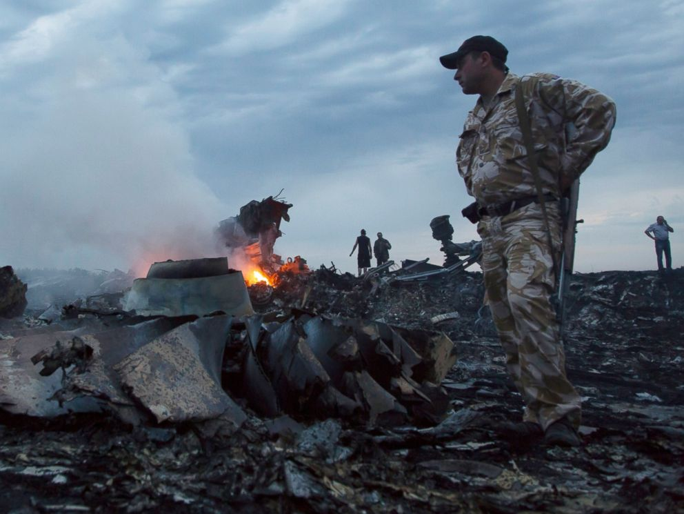 PHOTO: People walk amongst the debris, at the crash site of a passenger plane near the village of Grabovo, Ukraine, July 17, 2014.
