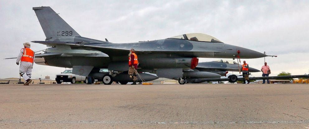 PHOTO: In this May 15, 2015, file photo, a boneyard crew tows an F-16 Fighting Falcon aircraft prior at Davis-Monthan Air Force Base in Tucson, Ariz.