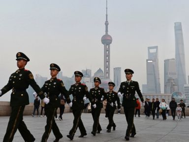 PHOTO: Chinese paramilitary police personnel patrol along the Bund, a popular tourist attraction in Shanghai, China, Dec. 31, 2015.