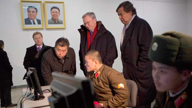 PHOTO: Executive Chairman of Google, Eric Schmidt, back row left, and former Governor of New Mexico Bill Richardson, back row right, look at North Korean soldiers working on computers at the Grand Peoples Study House in Pyongyang, North Korea, Jan. 9, 201