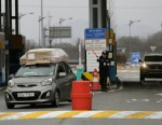 PHOTO: South Korean vehicles returning home from North Koreas Kaesong arrive at the customs, immigration and quarantine office near the border village of Panmunjom, which has separated the two Koreas since the Korean War, in Paju, north of Seoul, South K