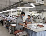 PHOTO: North Korean men are seen working for ShinWon, a South Korean clothing maker, preparing garments for production at a factory in Kaesong, North Korea, Sept. 21, 2012.