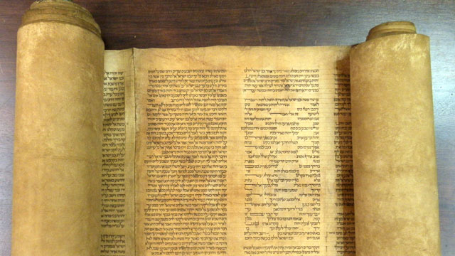 PHOTO: A document that an Italian expert says to be the oldest known complete Torah scroll is seen at the Alma mater Studiorum Universita di Bologna.