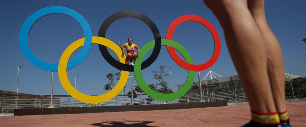 PHOTO: Spanish cyclists pose for a picture on the Olympics rings in the Olympic Park ahead of the 2016 Summer Olympics in Rio de Janeiro, Brazil, Aug. 1, 2016.