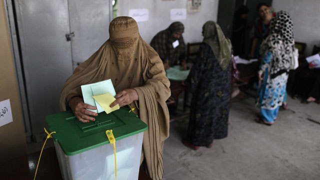 PHOTO: A Pakistani woman casts her ballot at a polling station on the outskirts of Islamabad, Pakistan, Saturday, May 11, 2013.