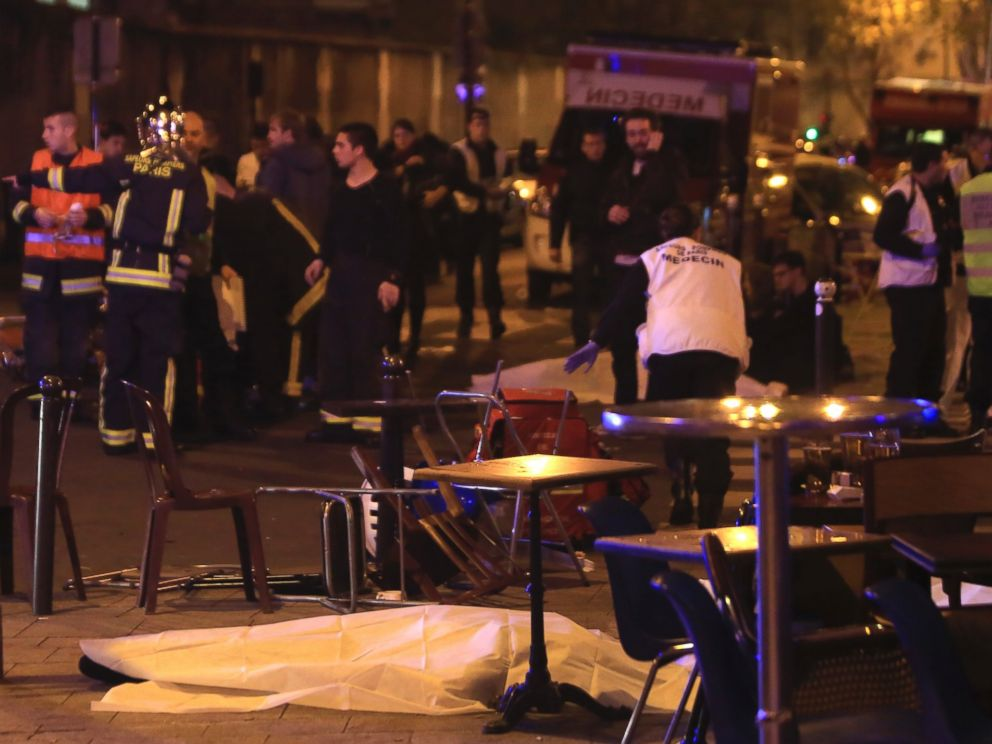 PHOTO: Rescue workers and medics work by victims at a Paris restaurant, Nov. 13, 2015.